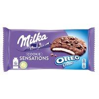 MILKA Cookie Sensations Ciastka kakaowe z kawałkami czekolady i nadzieniem o smaku waniliowym