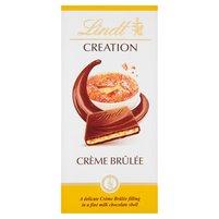 LINDT Creation Czekolada mleczna z nadzieniem mlecznym i kawałkami cukru karmelizowanego