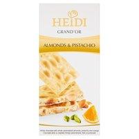 HEIDI Grand'Or Biała czekolada z kameralizowanymi migdałami kawałkami pistacji i pomarańczy