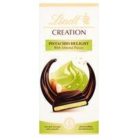 LINDT Creation Czekolada ciemna z nadzieniem o smaku pistacjowym z kawałkami migdałów
