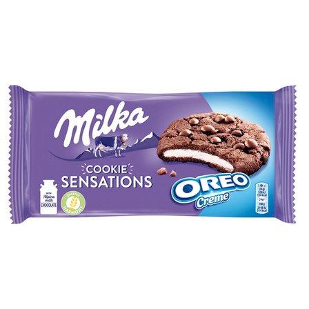 MILKA Cookie Sensations Ciastka kakaowe z kawałkami czekolady i nadzieniem o smaku waniliowym (1)